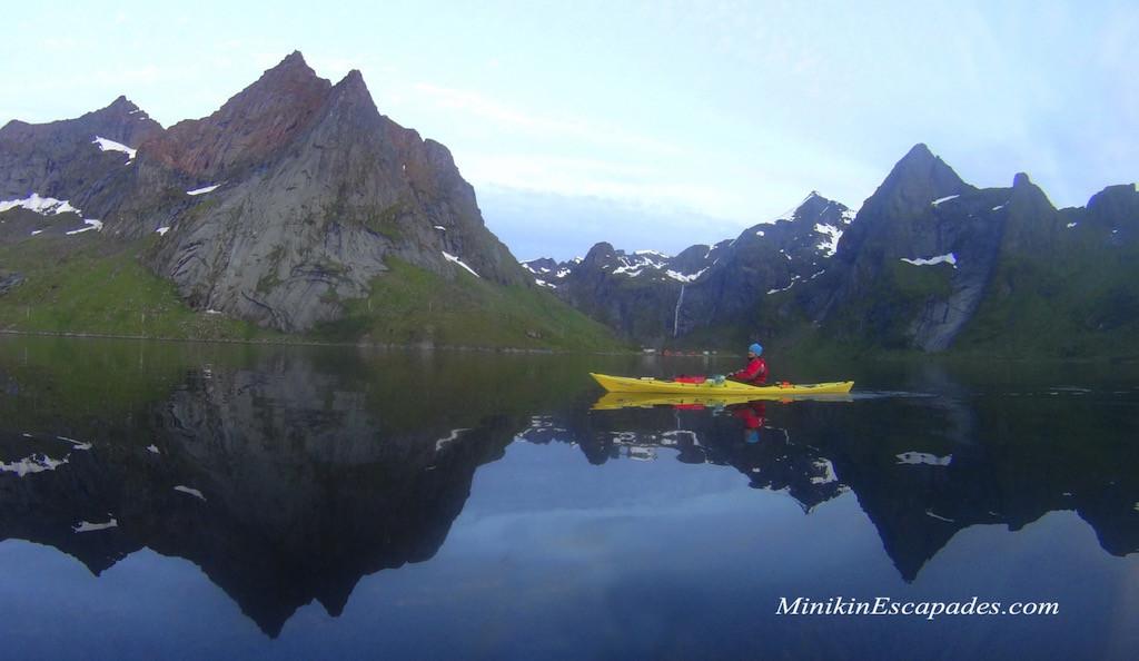 Kayaking A Craft In The Fjords Of Reine Lofoten Islands